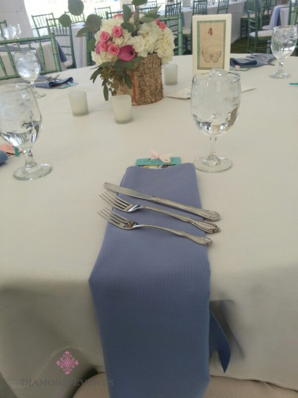 Blue napkin folded over the edge of the table