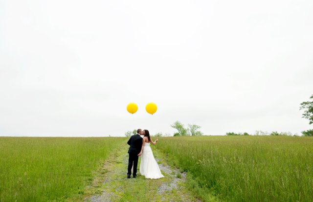 Bride & Groom with yellow balloons