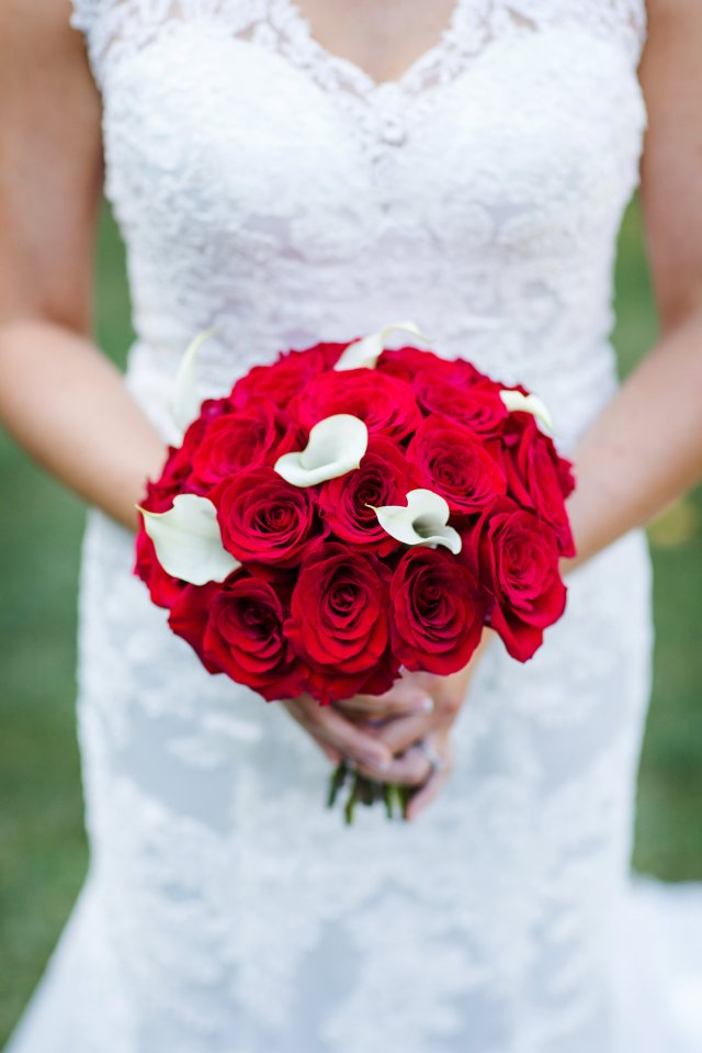 The bride's bouquet contained red roses and white calla lillies.