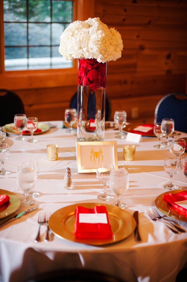 The superhero-titled tables with white hydrangeas and red roses.