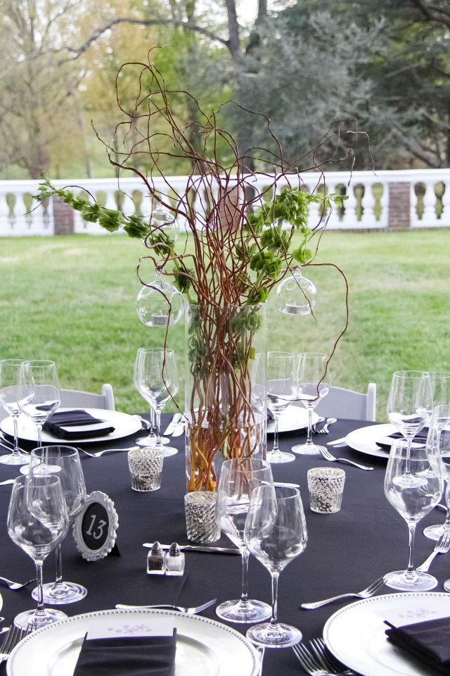 Tall centerpiece with bells or ireland, branches and hanging votives